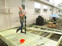 how to build a platform deck by yourself for cheap! Building A Floating Deck, Building A Porch, House Building, Floating Deck Plans, Floating Stairs, Building Ideas, Deck Building Plans, Platform Deck, Floating Platform