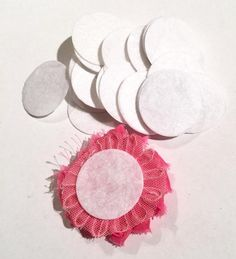 1.5 inch white die cut felt circles. Hundreds of elastics, FOE, flowers, rhinestones, jewelry findings & more too!