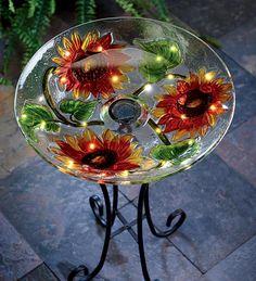 Diy birdbath -- inexpensive plant stand spray painted & add an unwanted or garage sale find platter.