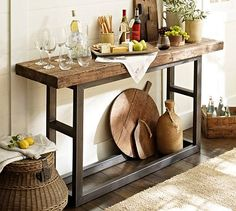 "I love the combination of the rustic and industrial in this console table. Whether you use it behind a couch or as shown here. Would look great with a rustic wine rack mounted above it for a bar affect. It's called the ""Griffin Console Table"" and it's from #potterybarn"