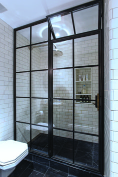 Our Frankford Panel System Shower Door is a master piece suited for a dream bathroom. This loft and industrial look in amazing!