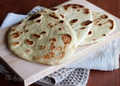 An easy to make Indian Flatbread that is ready to eat, fresh and hot from the oven in about an hour using quick rise yeast and a mixer to do the kneading for you.