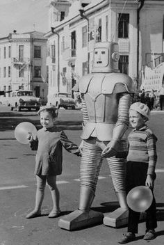 1967 U.S.S.R.  robot traffic controller takes two youngsters across a busy street
