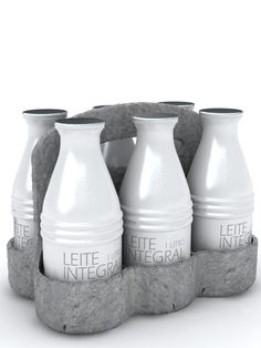 aluminum milk pack | Baita Design  I love this presentation but I would wonder if I were paying too much for my  milk because the packaging was so fabulous. I would have to find a way to reuse the bottles and the carrier to make the added expense justifiable.