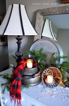 Old kettle and drain cover snow covered candle vignette - part of An all natural junk filled 2011 Christmas home tour, via Donna at Funky Junk - my inspiration this year with an industrial twist