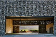 Dominus Winery by Herzog & De Meuron elevates the utilitarian gabion from a retaining wall workhorse to a sun dappled architectural surface