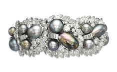A PEARL AND DIAMOND BRACELET, BY CARTIER Designed as seven graduated openwork stylized leaves, each set with three drop, button or baroque-shaped coloured pearls, with brilliant-cut diamond detail and marquise-shaped diamond border, to the scroll clasp, mounted in platinum, 17.0 cm Signed Cartier London