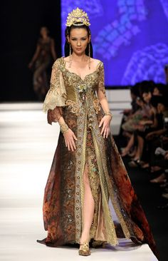 A model showcases designs on the runway by Anne Avantie as part of APPMI Show 4 on day three of Jakarta Fashion Week 2009 at the Fashion Tent, Pacific Place on November 16, 2009 in Jakarta, Indonesia.
