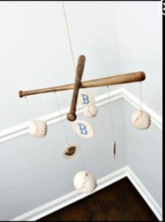 Baseball nursery baseball mobile... I would give into a sports nursery for this!
