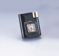 CARTIER. AN 18K GOLD, SILVER AND LACQUER LIGHTER WITH BUILT-IN WATCH  $7000 in 2002