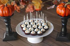 #MustTry Pumpkin Pie Truffle Pops | Classic Nilla Wafer cookies are blended with pumpkin puree and cream cream to create a moist cake pop.  The chilled balls are dipped in chocolate and decorated with pumpkin shaped candies.  This petite fall dessert is perfect for big family gatherings or festivals. ~ #fallrecipe
