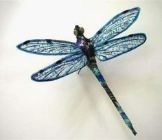 Each dragonfly is around 7″ long and starts with an 18″ piece of florist wire. More wire is used to create the standing feet, eyes are made of beads and the wings are hand painted kozo paper with a wire frame. The body is wrapped with translucent ribbon.