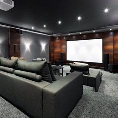 Wood Panel Walls In Home Theater With Grey Color Scheme