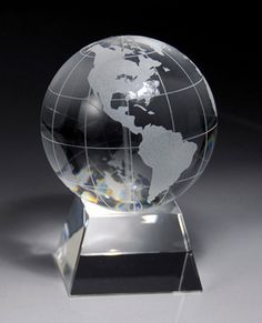 """The Crystal World Globe Pyramid Award is crafted from pure optic crystal and available in three sizes, 3.5"""", 4.5"""" and 6"""" height. The globe diameter is 2.25"""", 3"""" and 4"""" respectively. This is a clean and simple award design where a crystal globe with etched continents sits atop of a slanted optic crystal base. The base is custom engraved with your supplied text and logo. This award ships in a premium quality presentation box.      http://www.edco.com/corporate-awards"""