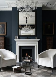 dark blue living room. Love the contrast of dark walls and white furniture  Transitional Living Room by Paul Craig Photography 15 Beautiful Dark Blue Wall Design Ideas Navy blue White