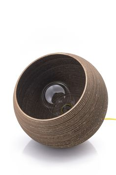 Cardboard lamp concept - entry for competition by Ulrik Rosenørn, via Behance