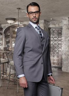 2 button charcoal gray Italian wool suit for men.
