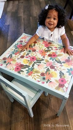Ikea Hack - Latt Children's Table -- I like the idea of painting this and putting cute contact paper on the top (or maybe clear contact paper over a cute wallpaper or wrapping paper) -- easier to clean