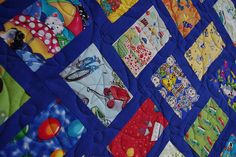 I Spy Quilt - I'd never heard of these before, tons of fun fabrics with things for your little one to look for!  Love!
