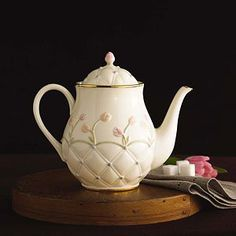 Delicate sculpting adorns this exquisite teapot with a light and cheerful tulip pattern. The lid is decorated with one beautiful bud as the finial.