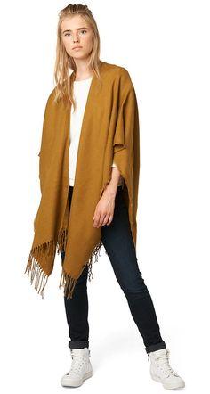 Poncho-Tuch für Frauen (unifarben, rechteckig geschnitten, vorne offen) aus Twill, mit Fransen-Besatz am Saum. Material: 100 % Polyacryl...
