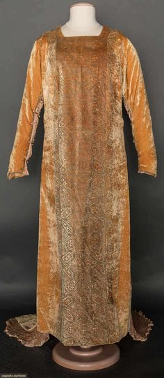 "Golden ochre silk velvet tabard w/ Persian pattern gold stenciling, peach pleated silk sleeve & dress side panels enclosed w/ Murano glass beads & silk cord loops, silk lining, circular label ""Mariano Fortuny Venise"","