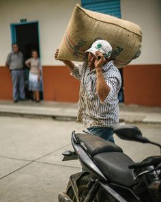 "Coffee farmer Carlos Arturo carries a bag of green coffee beans to his cafe in Pijao ""cafe la floresta"" @dustyleah & I sampled a delicious @chemex during our visit. They swear by the Chemex brew method. #espresso #beantocup #coffeeandtravel @experienciacafetera #coffee #chemex #crema http://ift.tt/1U25kLY"