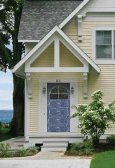 Pale yellow & white with distressed blue door yellow house exterior, exterior paint colors for Yellow House Exterior, Exterior Paint Colors For House, Paint Colors For Home, Exterior Color Schemes, Yellow Houses, Brick And Stone, Cool House Designs, House Painting, Light Colors