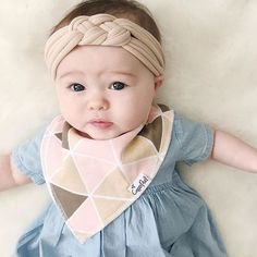 - Blush Designs for Girls - Designs include gold polka dots, pink herringbone, black and white hearts, and pink and tan triangles. - Absorbent cotton drool bib - These stylish drool bibs are made of 1