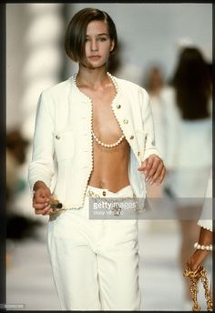 A model walks the runway during the Chanel Ready to Wear show as part of Paris Fashion Week Spring/Summer 1990-1991 in October, 1990 in Paris, France.
