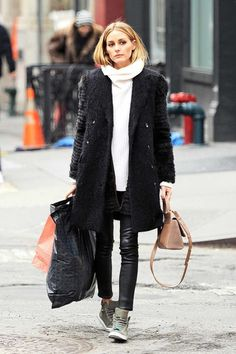 Olivia Palermo makes daywear chic in green trainers, skinnies and a chunky cream turtleneck sweater—proving casual doesn't need to feel lazy.