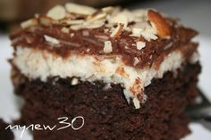 Almond Joy Cake . . . Delicious  1 (18 ¼ ounce) box dunkin hines devil's food cake mix   1 1⁄3; cups water   ½ cup vegetable oil   3 large eggs   1 cup evaporated milk   1 cup granulated sugar   24 large marshmallows   1 (14 ounce) package coconut   ½ cup evaporated milk   ¼ cup butter   12 ounces chocolate chips   sliced almonds , toasted     Read more: http://www.food.com/recipe/almond-joy-cake-114568#ixzz1n533UmYy