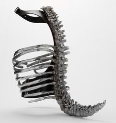 """""""Spine"""" Corset, designed by Shaun Leane for Alexander McQueen's S/S 1998 collection """"Untitled (The Golden Shower)"""". Photographed for the V&A Savage Beauty exhibit."""