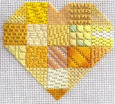 Canary Sapphire Heart, one of the Sapphires Stitch Samplers based on a patchwork design With over 50 stitches in the book $12  Image & project copyright Napa Needlepoint.