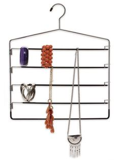 A five-rung pants hanger makes a great jewelry organizer.