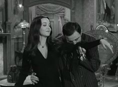 Gomez kisses Morticia's arm. (Scott and I did this at our wedding reception and played The Addams Family theme song! :)