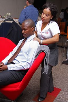 Virgin Spa giving quick shoulder massages to Discovery Invest Leadership Summit delegates.