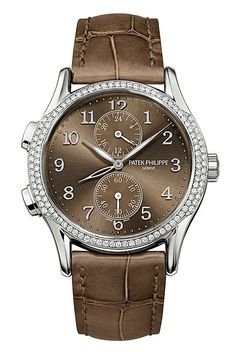 """Patek Philippe Ladies Calatrava Travel Time Watch - 7134G-001. 18k white gold case (35mm diameter), transparent case back, bezel set with 112 diamonds (0.59 ct approx), taupe alligator leather strap with 18k white gold buckle, brown sunburst dial with white gold applied Arabic numerals, dual time zone function (indicating local and home time), 24-hour """"home"""" time indication, seconds subdial, 18 jewel 215 PSFUS24H manual-winding movement with 44 hours of power reserve and Geneva Seal…"""