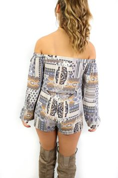 Navy romper is off the shoulder Romper features a drawstring tie waist Material is Polyester Romper is not lined Model Addi is 5'6 wearing size small Shop the s