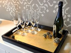 Dress up an inexpensive tray with gold leaf. It's easier than you think! See how: http://www.hgtv.com/handmade/how-to-make-a-gold-leaf-bar-tray/index.html?soc=hpp