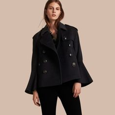 A slim pea coat made from a warming blend of wool and cashmere. The classic style is reimagined with bell sleeves to add movement and feminine detail.