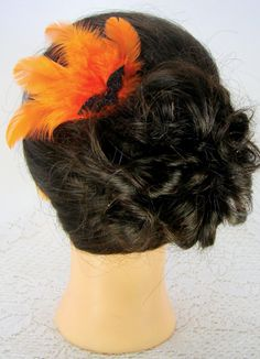 Halloween Fascinator Adult Costume Hair Accessories Black Orange Feather Fascinator Bat Comb Dance Hall Burlesque Flapper. $18.00, via Etsy.
