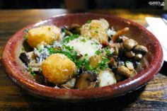 Mushrooms, provolone croquettes, red sauce and slow egg at The Old Crow