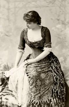 """Lillie Langtry, nicknamed """"The Jersey Lily"""", was a Victorian actress who became the lover of Edward VII. The king met her after deliberately contriving for them to be seated next to each other at a dinner party. Conveniently enough, Langtry's husband happened to be placed at the opposite end of the table."""