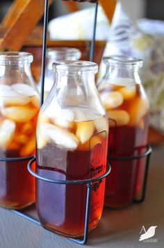 A cute way to serve ice tea for a party ... re-use Starbuck's bottles