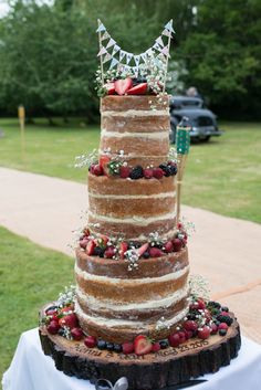 Naked Victoria Sponge Cake on an engraved wooden tree slab | Tipi reception at home filled with DIY Decor | Grey Bridesmaid Dresses | Gypsophila Flowers | Image by Hannah McClune Photography | http://www.rockmywedding.co.uk/henni-daniel/