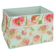 "Canvas trunk organizer with a mesh pocket and floral motif.   Product: Trunk organizerConstruction Material: Canvas and meshColor: Teal, pink and green Features: Outside mesh pocket Dimensions: 12"" H x 18"" W x 12"" D"