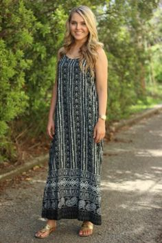 Midnight Dream Maxi $42  (Free Shipping)! This is a maxi you don't want to miss! The black and white pattern is so on trend! We are in love with the racer back, all you need to do is add your favorite wedges or flats! Nicole is a size 4 wearing a small and is 5'8.