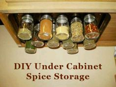 Screw cookie sheet to underside of cubbards, put spices in baby food jars, then put magnets on lids.