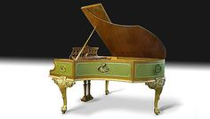 """Bechstein Grand Piano, 1898 Spectacular satinwood case highly decorated with painted and gilded inset panels with musical motifs. Carved and gilded cabriole leg stand and matching stool. 6'7"""""""